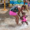 Caribbean Cove girl & grandmother In wading pool