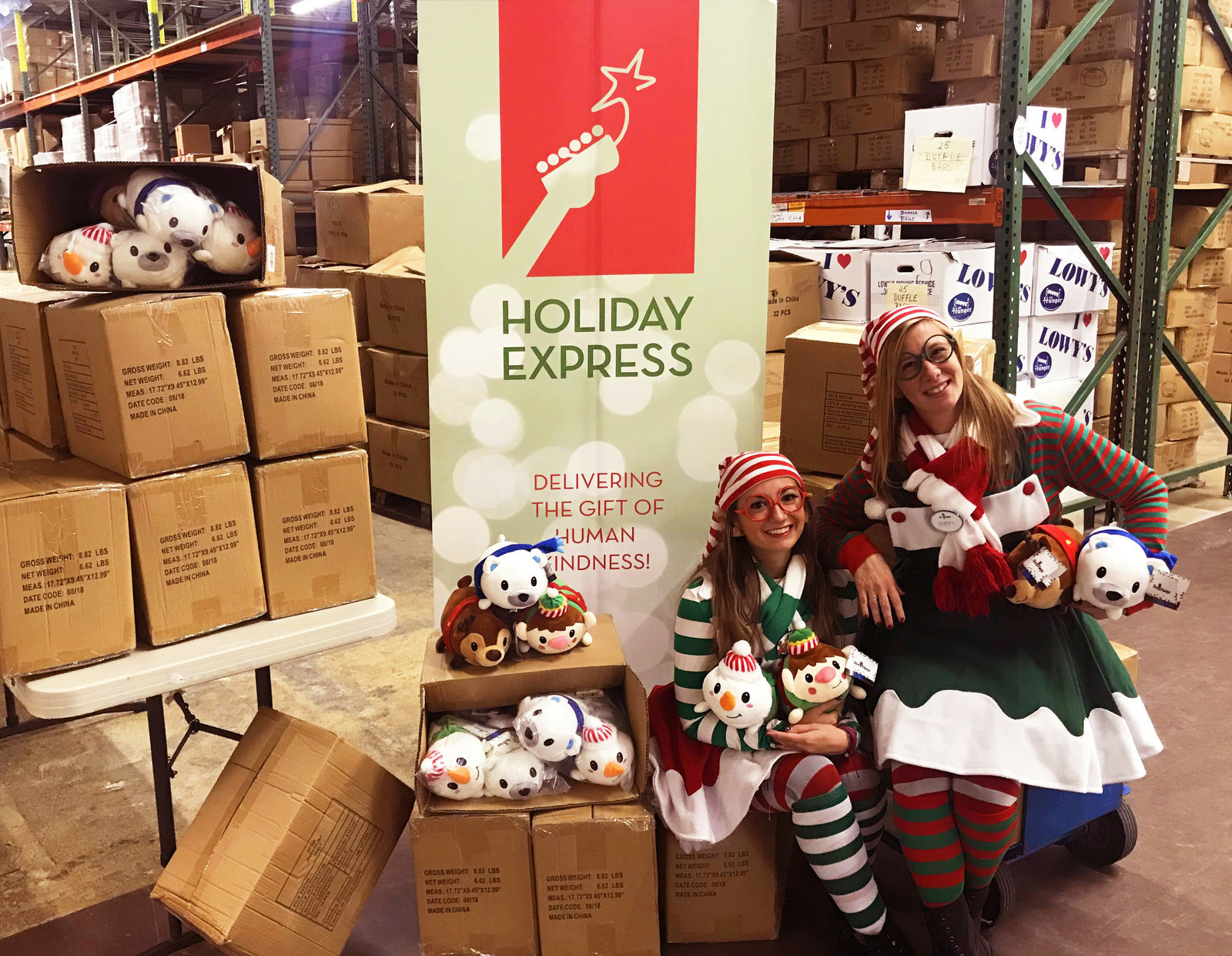 Elves deliver plush to Holiday Express.jpg