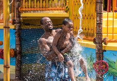 Caribbean Cove father & son in water spout.jpg