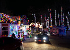 Cars drive past Santa's House.jpg